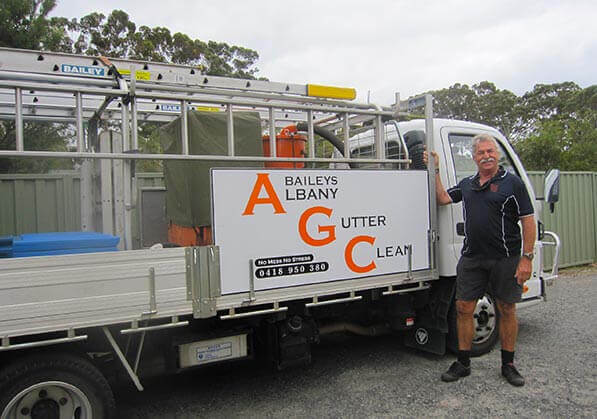 Tom next to Albany Gutter clean truck